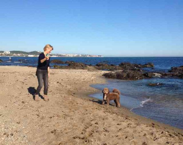 Heather & Flynn enjoying a game of ball on the beach, having just arrived back in Mijas Costa in S.Spain, from W.Wales.